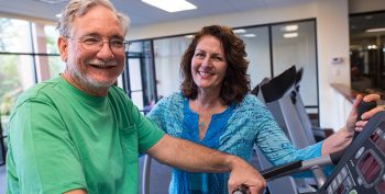 Man in rehab gym with therapist