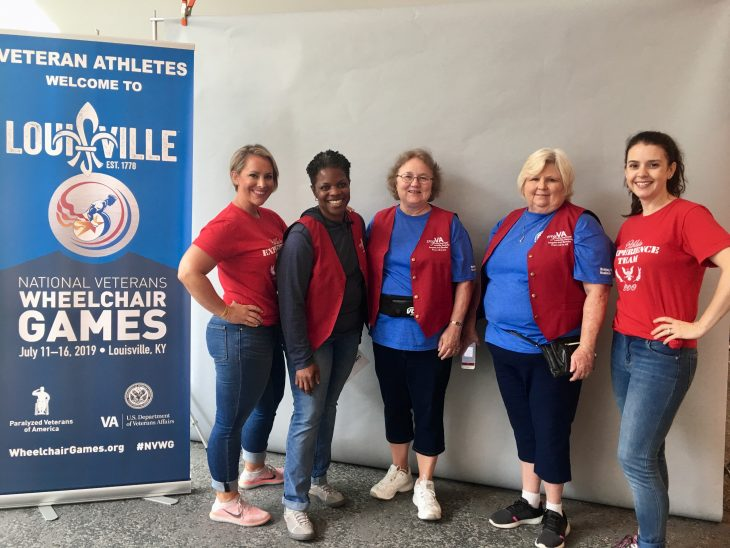 Some of the Red Coat Ambassadors and Athlete Experience Team from the Robley Rex VA that assisted Veterans and their families at the wheelchair games.
