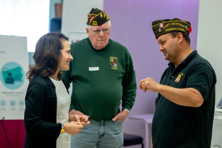 Deborah Lafer Scher, Executive Advisor to the Secretary who oversees the Secretary's Center for Strategic Partnerships, talks to Veterans from the Staff Sgt. Albert E. Moss Jr. Veterans of Foreign Wars Post 7842 in Linesville, Pennsylvania.
