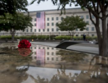 A red flower sits atop of every bench to remember the fallen on Sept. 11, 2001.