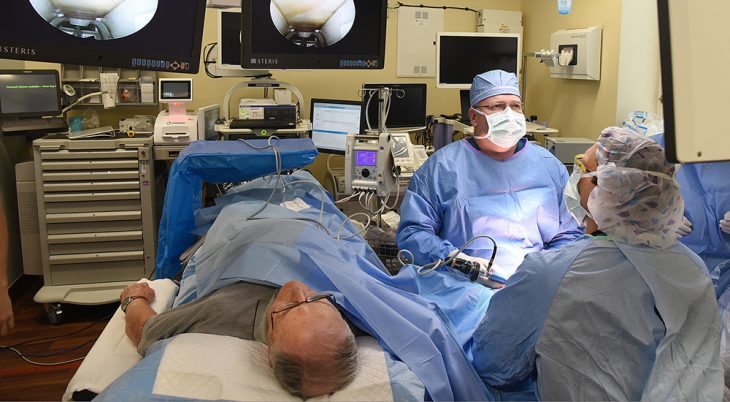 A doctor provides surgery on a patient's hand in the operating room