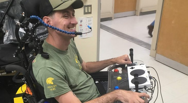 A man in a wheelchair with a custom video game controller