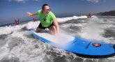 Blind, amputee and other Veterans learn firsthand about the healing waters of the San Diego surf at VA's Summer Sports Clinic.