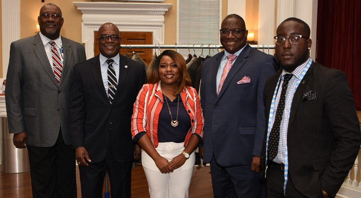 Four men and a woman dress smartly for success
