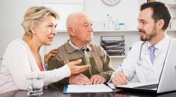 Mature couple having consultation with male doctor in hospital
