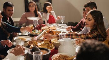 A large family enjoys an intimate family dinner