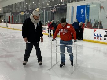 A Veteran learns to skate at the MedStar Ice Complex.
