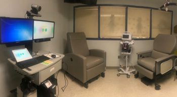 Chemotherapy treatment room with chairs and computer work station