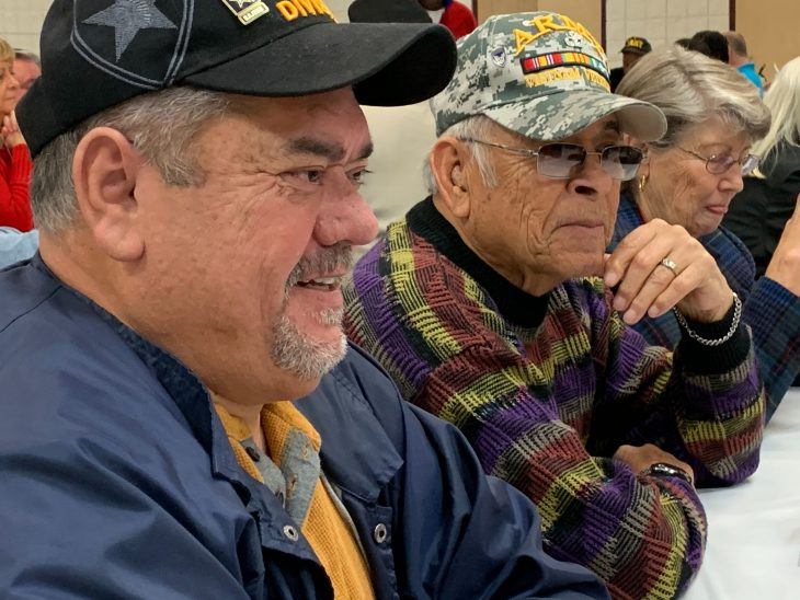 Veterans talk at the Christmas luncheon put on by the Fayetteville Vet Center Dec. 13, 2019.