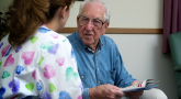 An elderly patient consults with his doctor