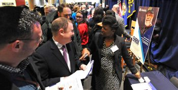 A person explains electronic health records modernization. at the fair Jan. 29 in Washington, D.C.