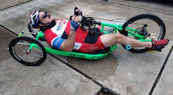 Man lying down in specialized bicycle