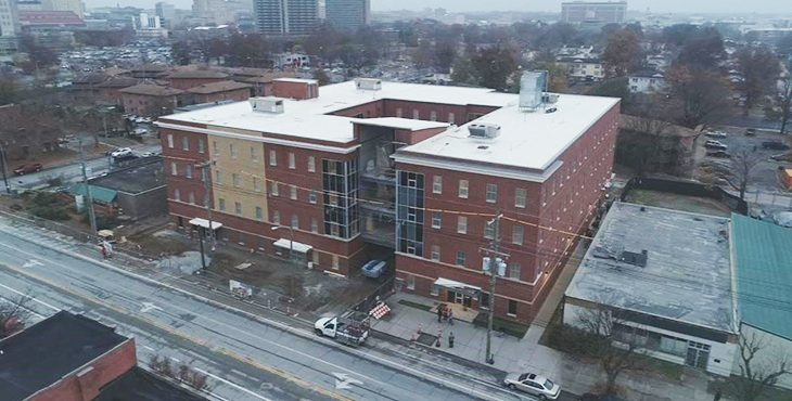IMAGE: An old looking large brick building
