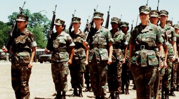 Female Marine Corps platoon stand at attention