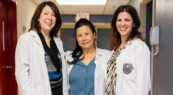 Three women medical clinicians who work with telehealth
