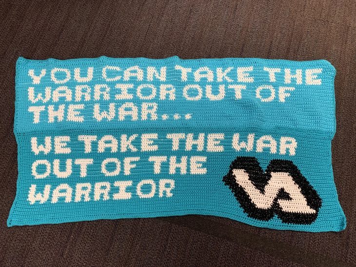 """Banner with words """"You can take the warrior out of the war...we take the war out of the warrior"""" with the VA logo."""