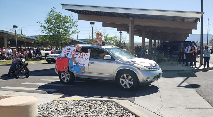 People in a car with signs