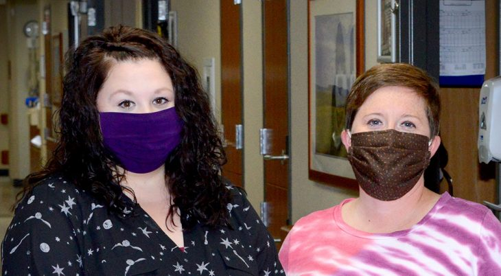 Two nurses who helped patients with a virtual connection