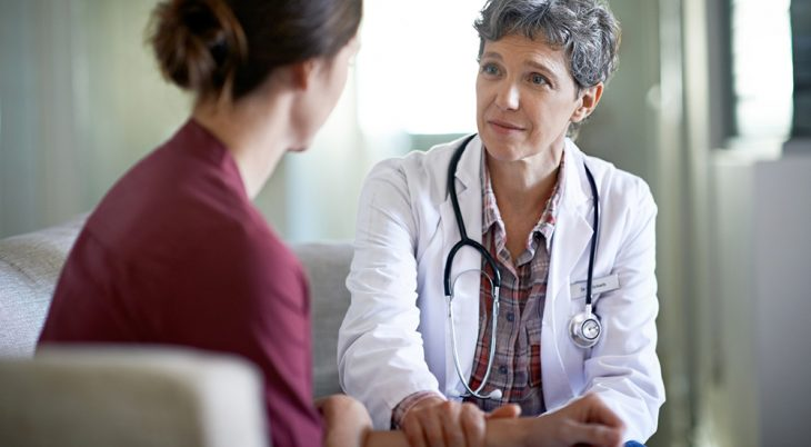A female doctor talks with a female patient regarding health care for women