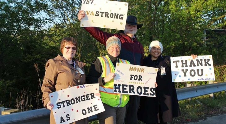 Group of people holding up signs