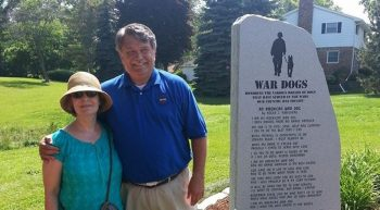 Man and his wife at a monument for dogs