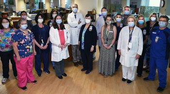 18 doctors and nurses wearing masks