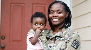 Army servicewoman with baby