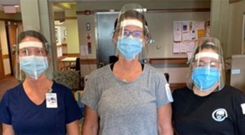 Three nurses wearing masks