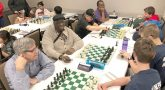 Large group of people playing chess