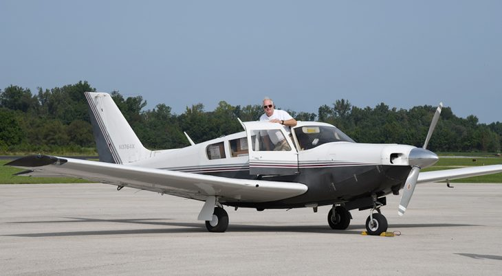 Pilot stepping out of small aircraft