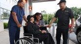 nurse pushes woman in wheelchair