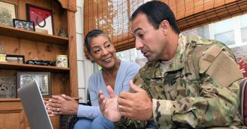 military member talking with female civilian