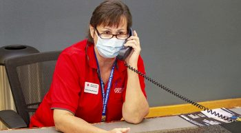 An American Red Cross volunteer on the phone