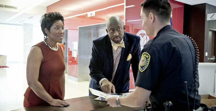 VA police officer helps employees locate an office.