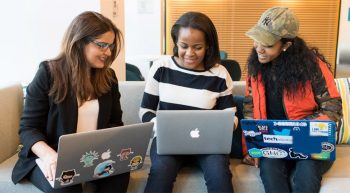 Three women working on laptops