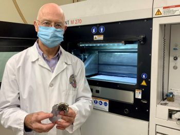 Dr. Richard Weir displays a prototype for one of his ongoing projects. It calls for developing a mechanical finger that can be sized for a female hand using 3D printing technology.