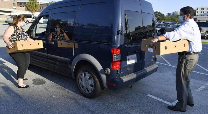 Man and woman loading boxes in a van