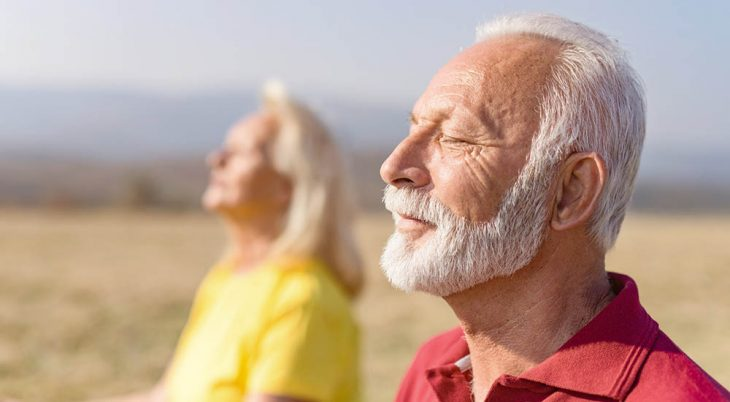 Man and woman meditate to help with PTSD