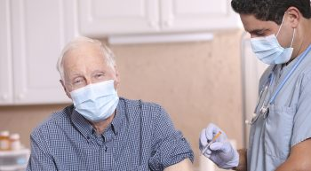 Elderly man getting a flu shot