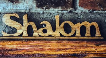 Wood carving of the word Shalom