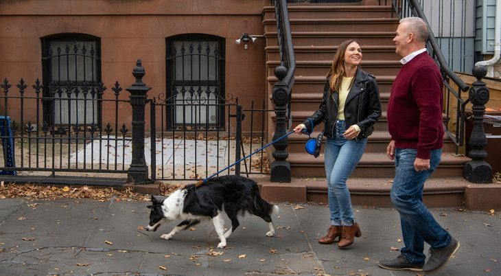 Man and woman walking their dog, using exercise instead of smoking as part of the Great American Smokeout
