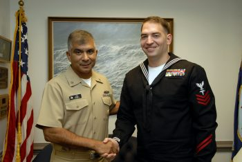 Navy Hospital Corpsman Lee Becker (right) with Master Chief Petty Officer of the Navy Joe Campa at the Pentagon in 2007.
