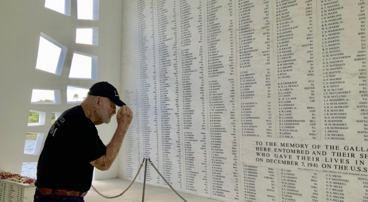 Man saluting names of Pearl Harbor victims