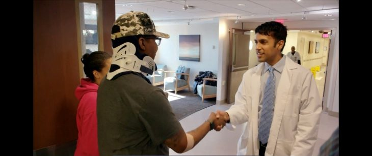 Veteran shakes hand with doctor
