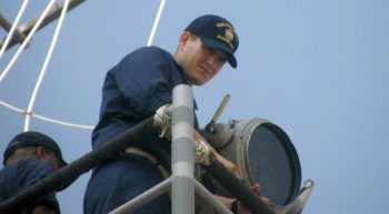 Navy seaman and searchlight on Navy ship