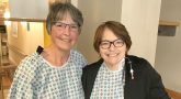 Two women in hospital gowns in hospital