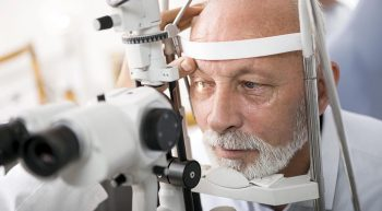 Senior male having eye exam