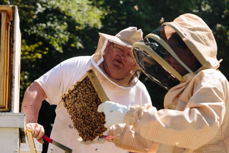 Eric Grandon checks bees at his farm in West Virginia.