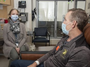 Dr. Julie Graff, an oncologist at the Portland VA, consults with Army Veteran David Atkinson. She's using precision oncology to treat his aggressive prostate cancer.