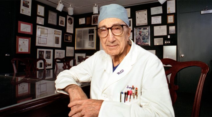 Doctor in surgical wardrobe in his office
